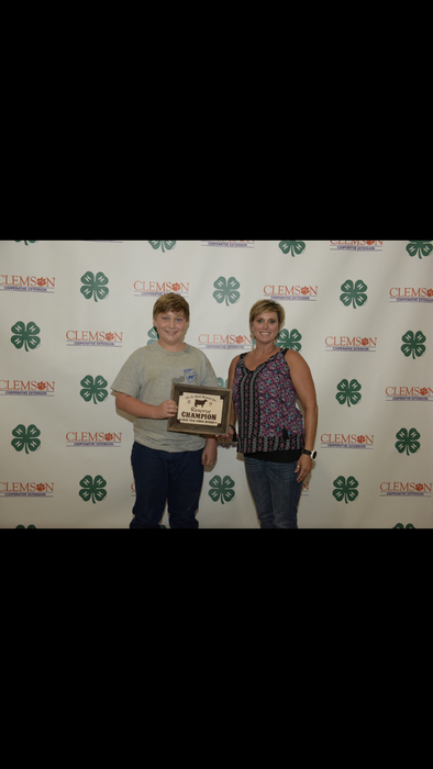 Brent Erwin receiving his award for Reserve Champion Junior Sales Talk.