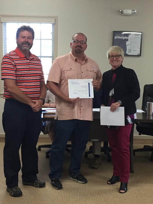 Chairman Marty Watt and Superintendent Kathy Hipp present Danny Owens his level 2 pin and certificate.