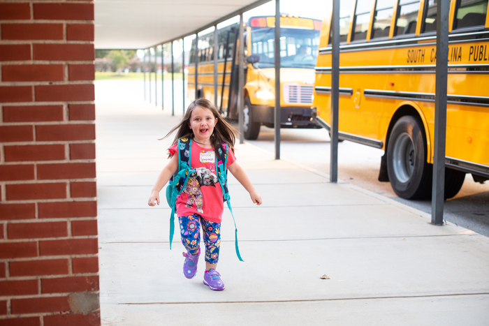 Students at Starr Elementary walk in on the first day.