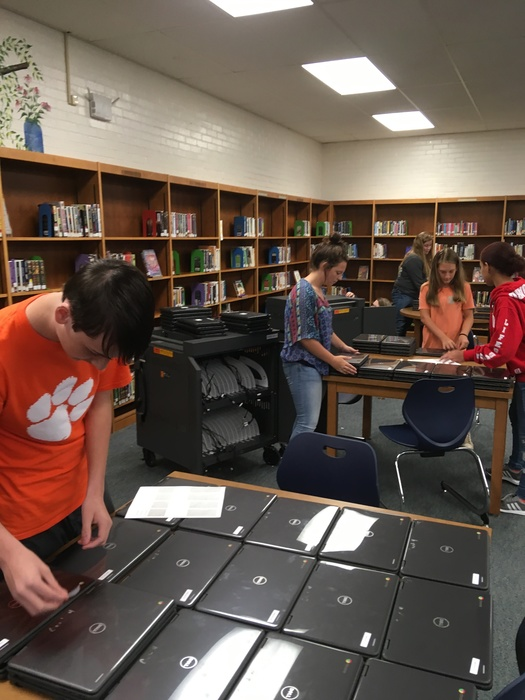 Ms. Russell's class preparing Chromebook carts.