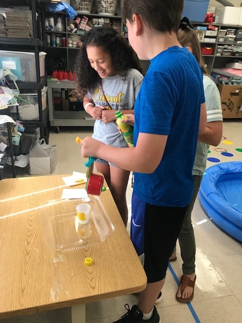 Students experiment with lemonade recipes.