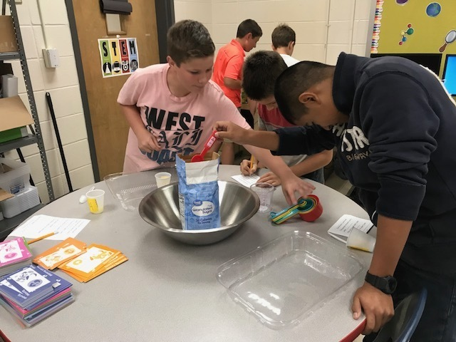 Students measure ingredients for lemonade.
