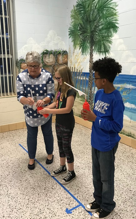 Students compete with their rockets.