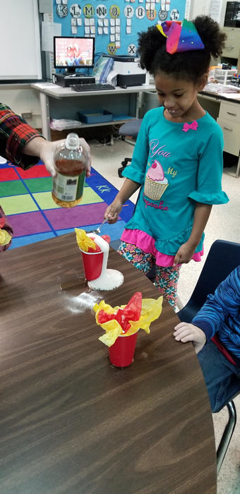 Students conduct an experiment after a unit on fire safety.