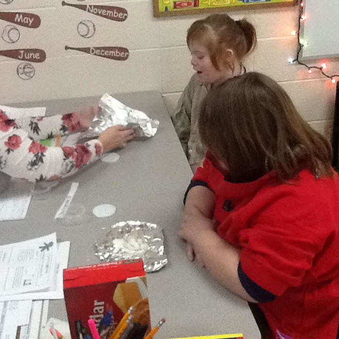 Students create gingerbread play-dough.