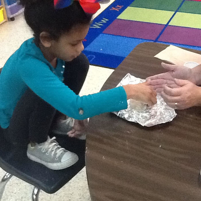 Students work with gingerbread play-dough.