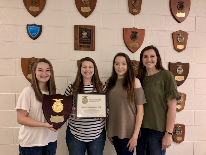The Crescent FFA Livestock Judging Team: Hannah Wooten, Abi Clinkscales, Michaela Herring and advisor, Caroline Davis.