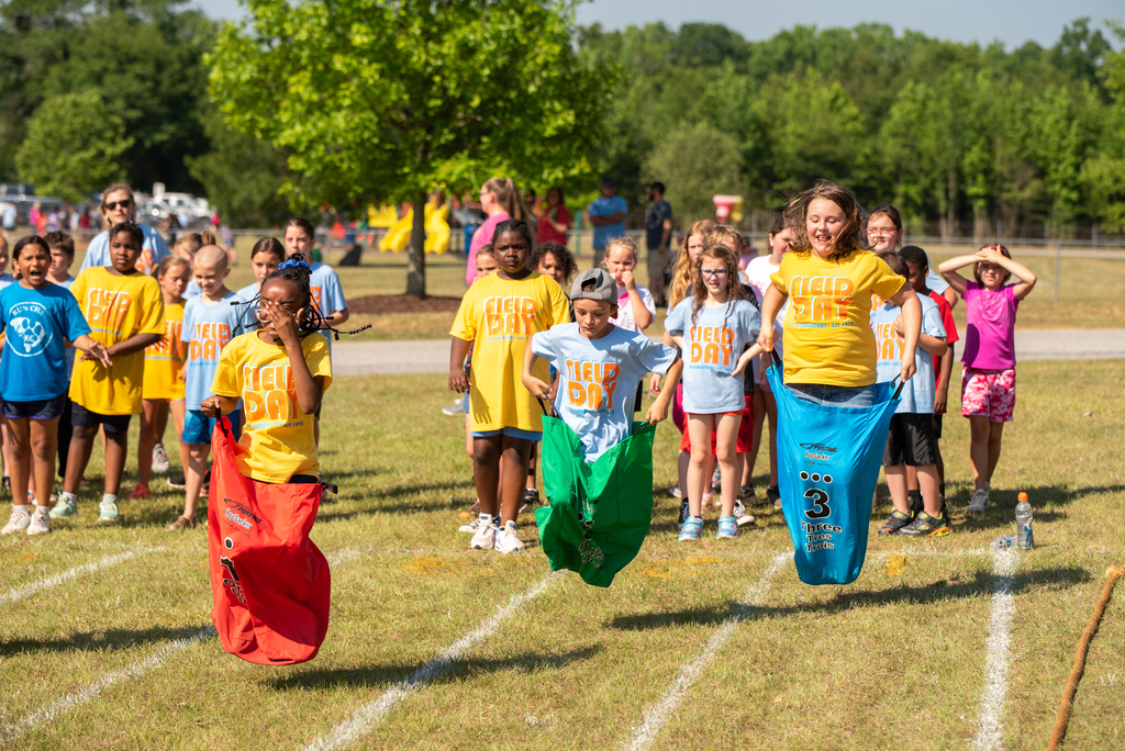 Students participate in a sac race.
