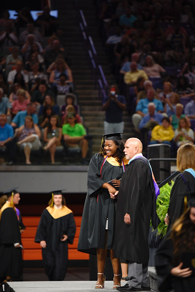 Graduate shakes hands with Principal Jacks